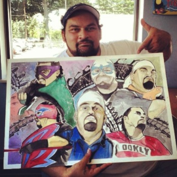 Admiring his self portrait, Matt Anoai, one of the many family memebers of the Samoan Dynasty